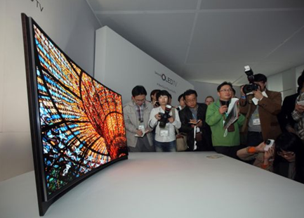 reporters with samsungs curved screen OLED TV television