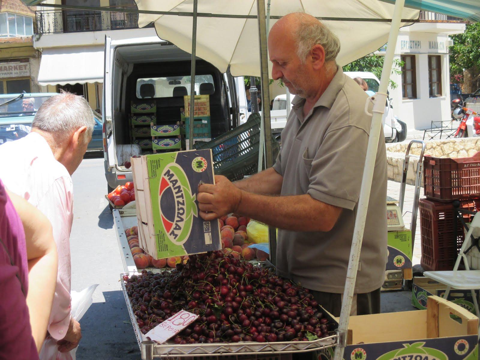 Man Selling Cherries at Farmers' Market, Chania, Crete, June 2015