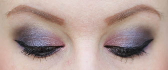 Purple eyes close up looking down