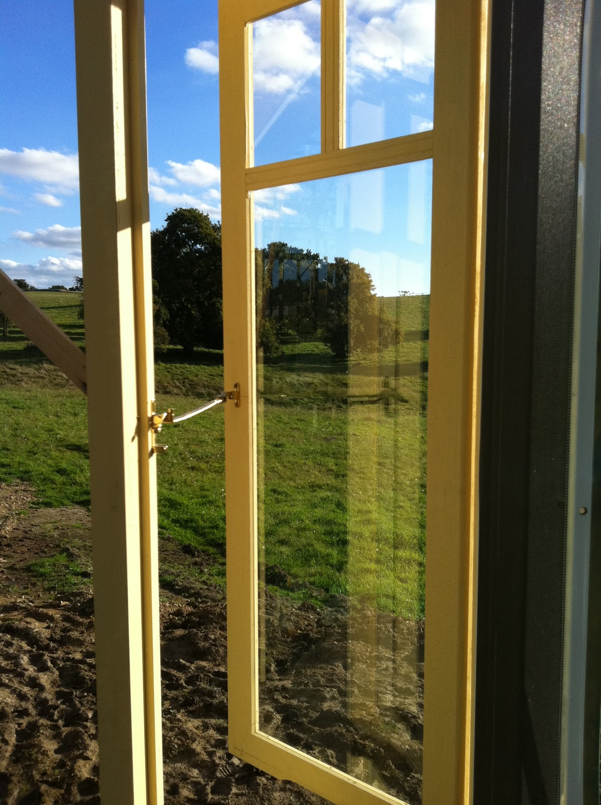 White verandah windows for French doors with windows either side