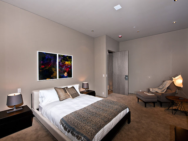 Photo of one of the modern bedrooms in the luxury modern Hollywood house