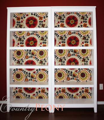 fabric paneled bookcase
