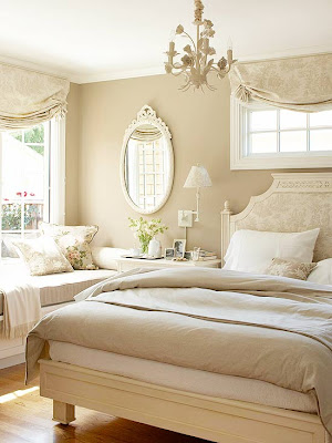 Soft taupe and cream toile fabric adorns the windows and headboard in this