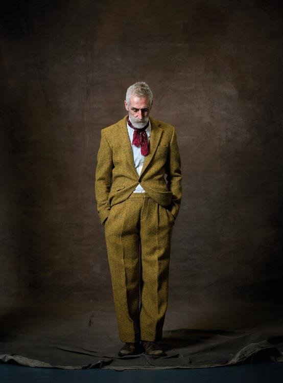 Older man in Harris tweed suit