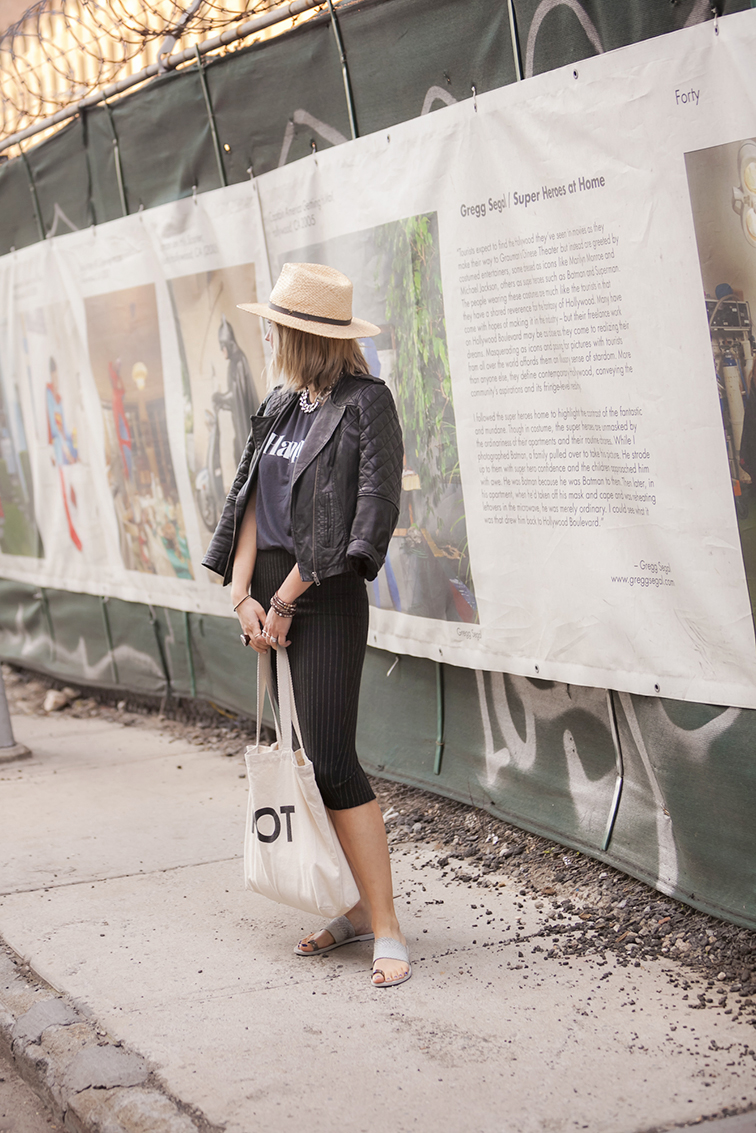 Quilted leather jacket, Vince silver toe ring sandals, pinstipe skirt, wide brim straw hat, Brooklyn NY