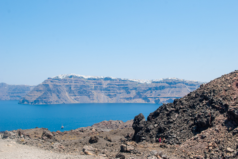 volcano near santorini, red and brown striped rocks