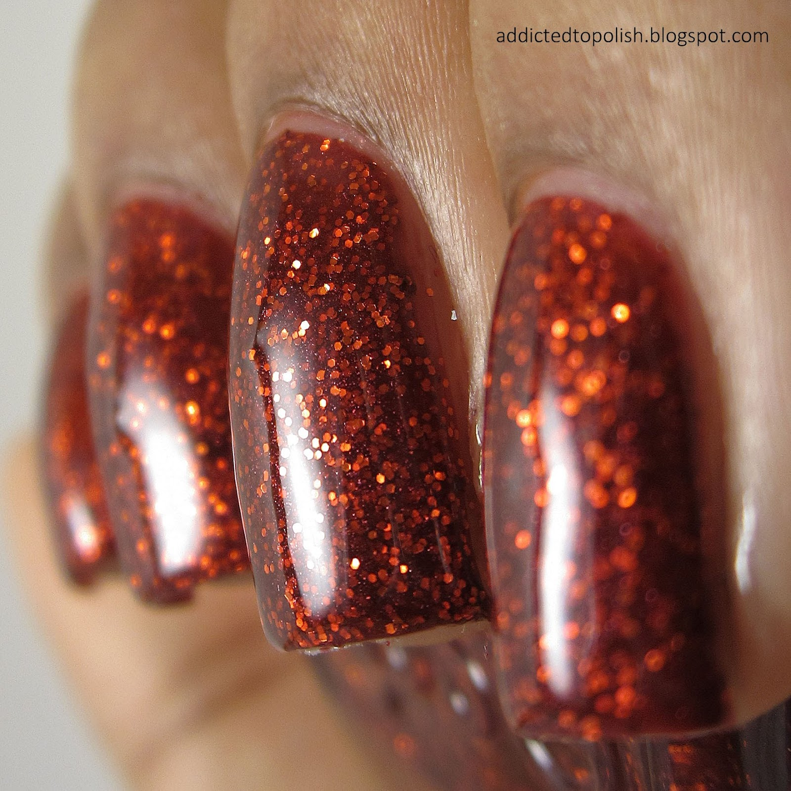 Essie-Ruby-Slippers-Red-Glitter-Nail-Polish