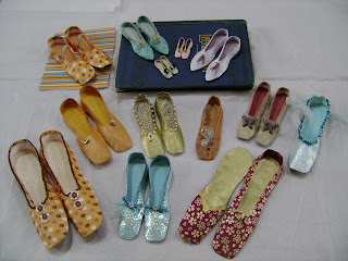 A selection of miniature paper shoes made by members of Skipton EG
