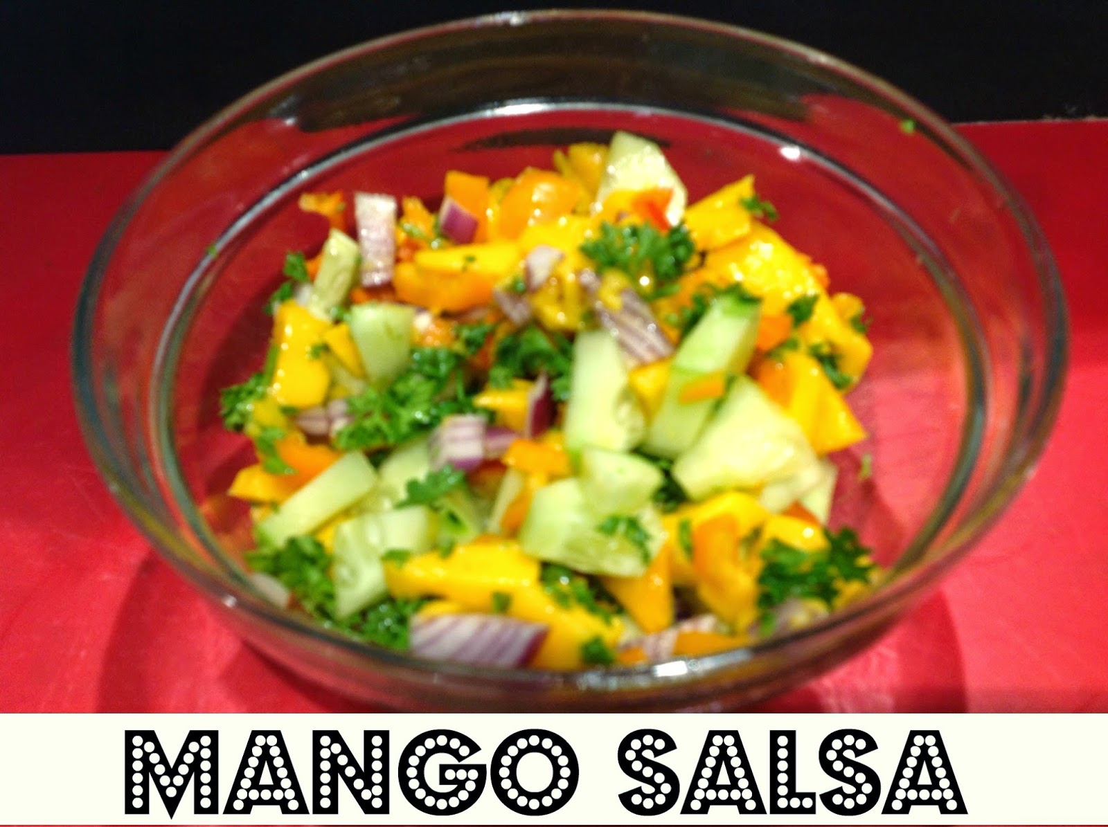 homemade mango salsa in a glass bowl