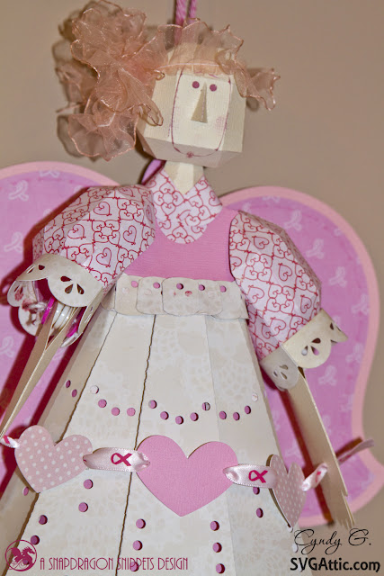 Close up of breast cancer angel