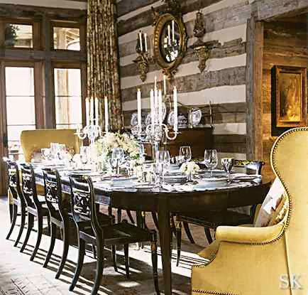 Dining room with reclaimed wood paneled walls