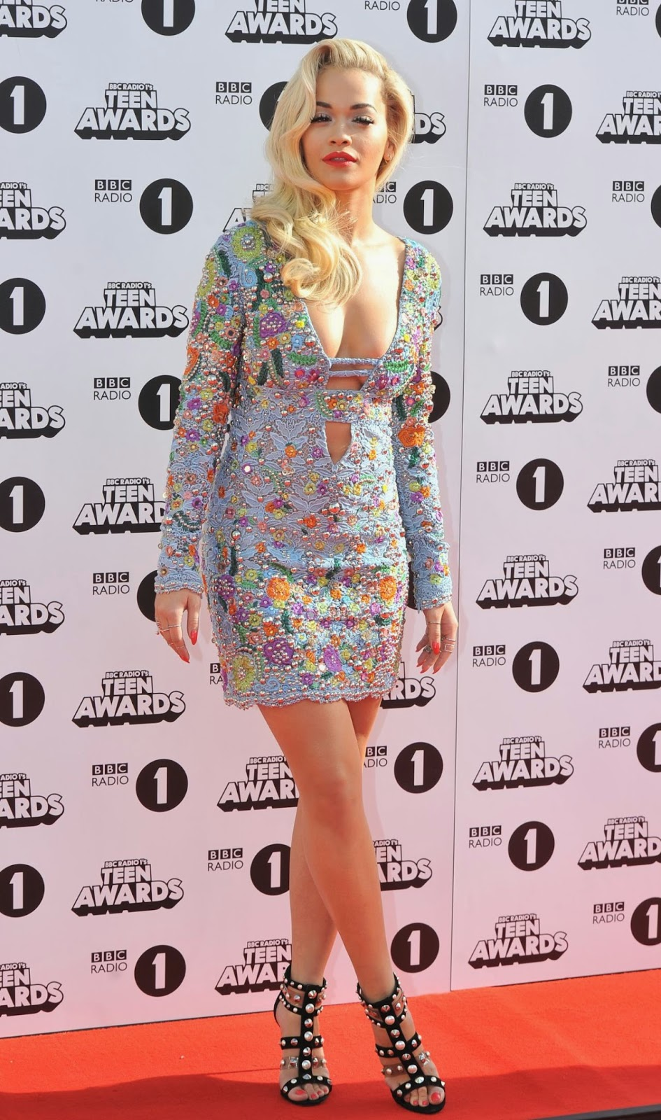 Rita Ora in a low-cut mini dress at the 2014 BBC Radio One Teen Awards in London