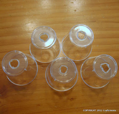 Plastic shot glasses with holes in the bottom