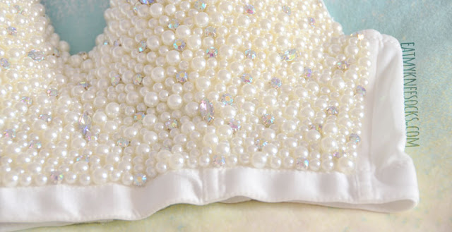 Details on the cream pearls and rhinestone/diamond-studded front on the beaded bustier top from SheIn.