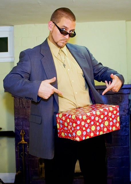 Man with present box on crotch