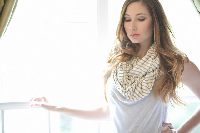 Amy West wearing Nuroo nursing scarf