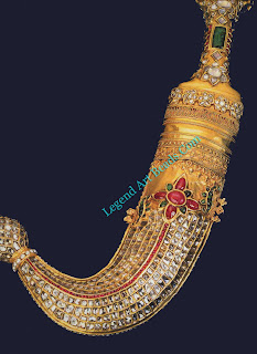 A khanjar, or curved covered in sheet gold and with table-cut diamonds, pearls, and cabochon rubies and emeralds. north Indian, 19th century.