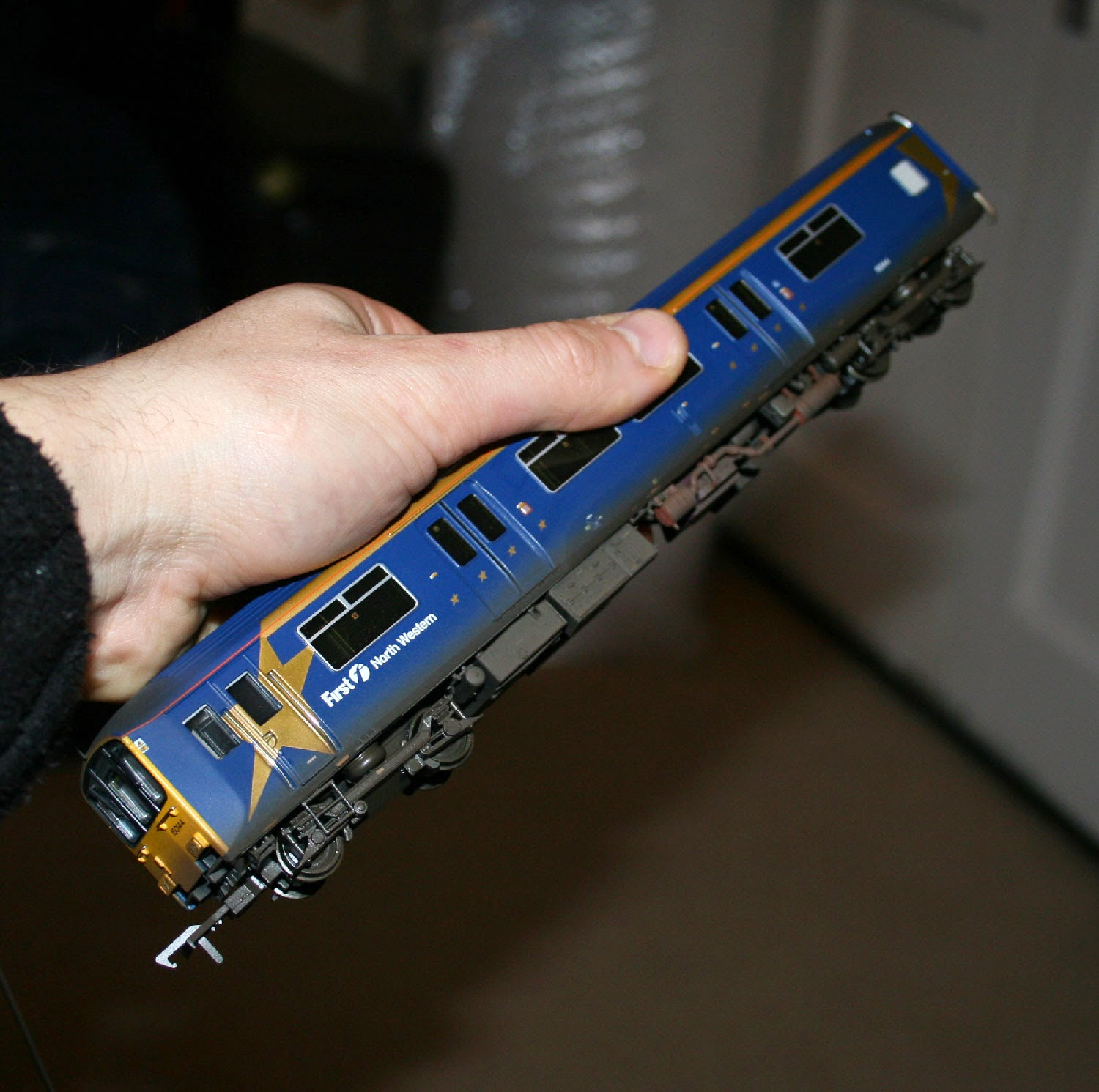 Weathered Class 150 in First Northwestern colours