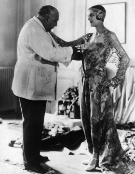 "Paul Poiret and model, showing his ""Oriental"" influenced fashion"