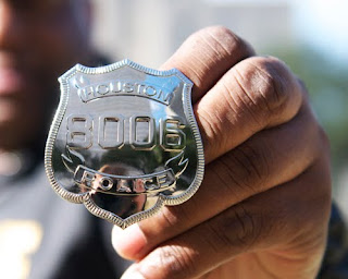 The Houston Police Department badge.