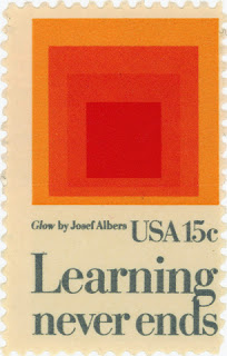 Stamp by Josef Albers reading Learning Never Ends