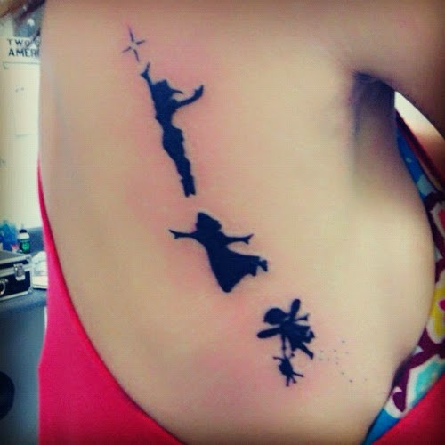 Art Tattoo feminina costela fadas