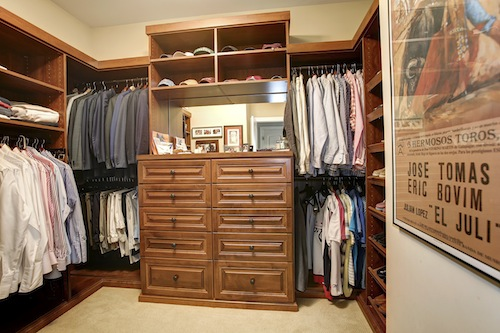 HIS CLOSET   This Is Truly A Manu0027s Closet, From The Dark Stained Custom  Cabinetry To The Wall Decor And Sports Memorabelia. Like Her Closet, The  Central ...