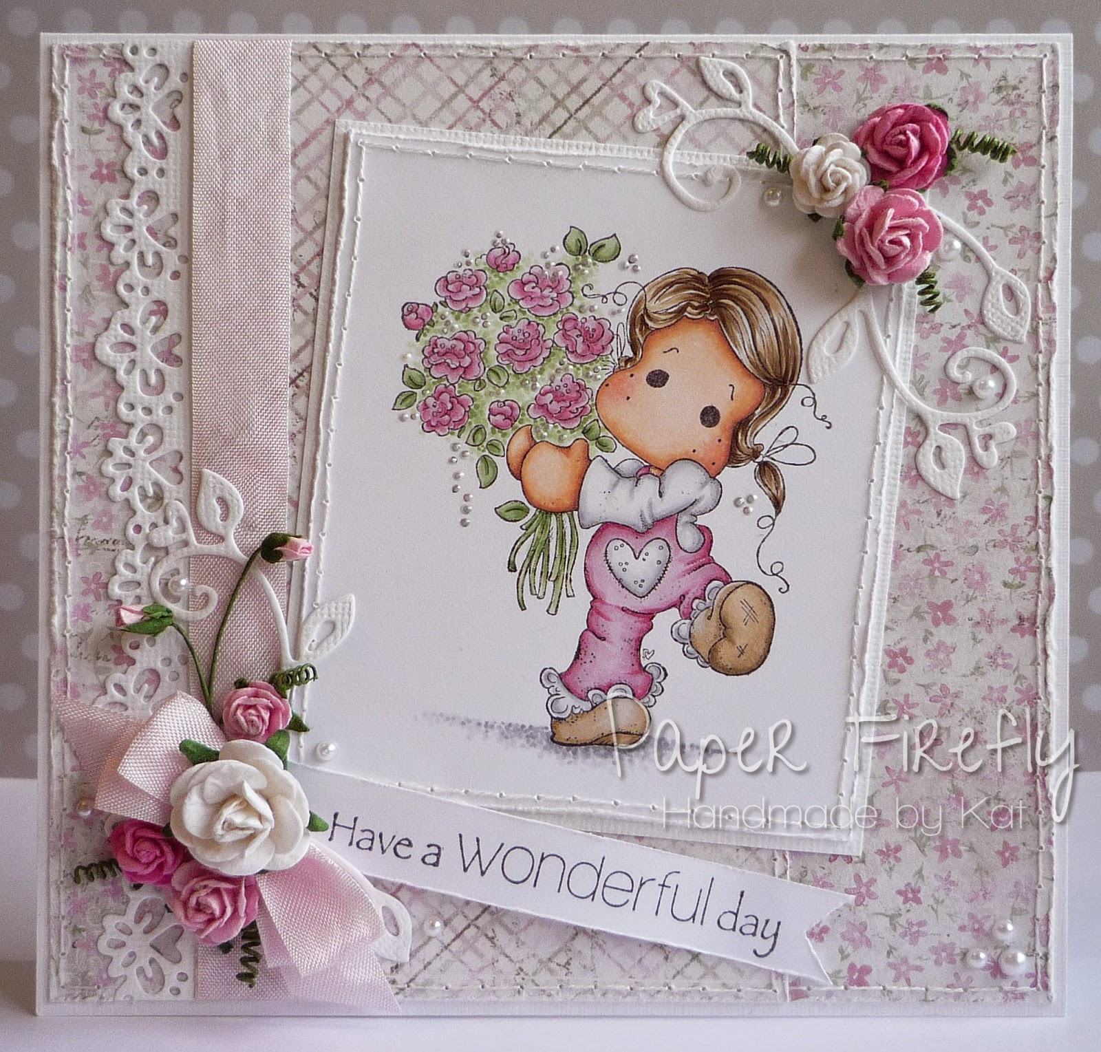 Pink and girly card featuring Tilda with flowers, and pearl, flower and ribbon details