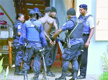 Image result for trinidad police making arrest