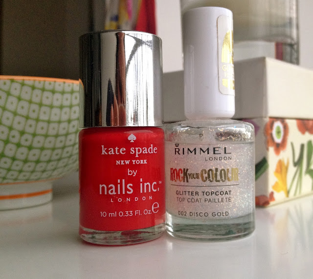 A picture of the perfect red nail polish and a glitter top coat