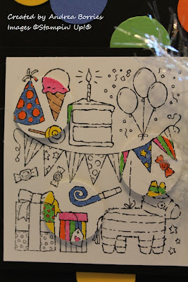 Close up of focal image: a variety of birthday things -- balloons, presents, etc. -- stamped in black and white with certain areas colored in.