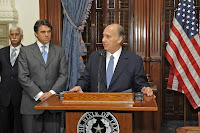 His Highness the Aga Khan addressing the media prior to the signing of the Memorandum of Understanding between the University of Texas and the Aga Khan University, as Governor Rick Perry of Texas listens intently.