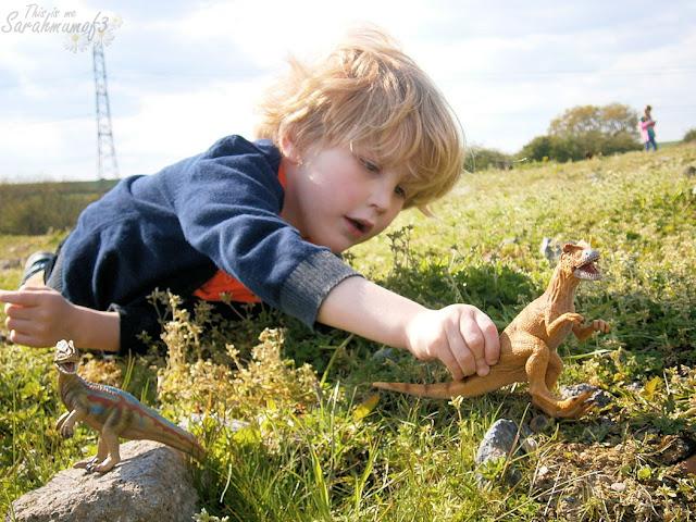 boy playing donosaur toy