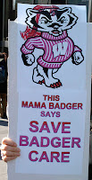 sign with badger illustration saying, This Momma badger says save badger care.