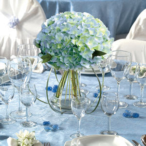 Our blue starburst centerpiece is a sparkling table centerpiece that will definitely jazz up any party or event. Perfect for birthdays, proms, New Year's Eve and much more. This blue starburst centerpiece has a base wrapped in blue foil with sprays with metallic blue stars bursting out.