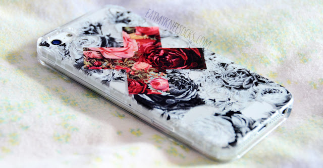 Close-up on the beautiful floral print on the contrast floral X phone case from Clash Cases.