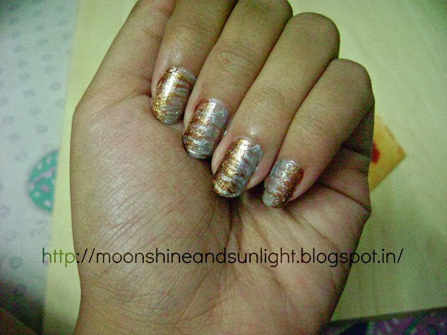 http://www.moonshineandsunlight.com/2013/07/metallic-marbled-nail-art-moonshine-and.html