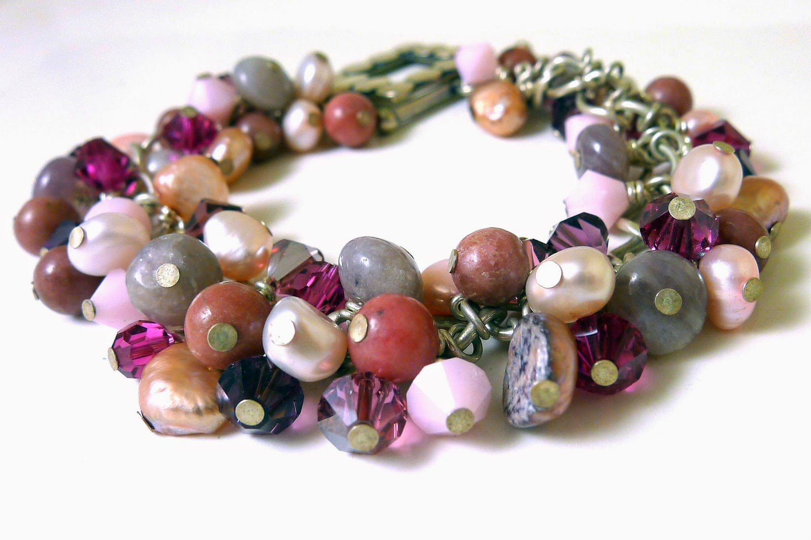 http://www.shazzabethcreations.co.nz/#!product/prd1/2442531711/pink-gemstone-charm-bracelet