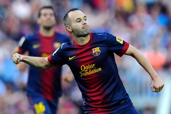 Barcelona player Andrés Iniesta celebrates after scoring his side's fourth goal against Málaga