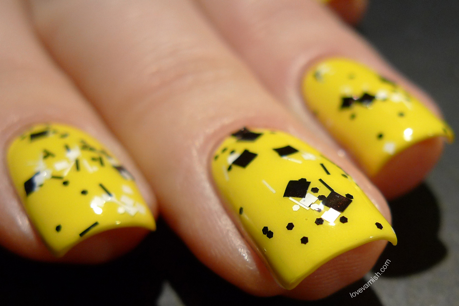 OPI Just Can't Cope-a-Cabana yellow creme and Dance Legend Geometric Topcoat black & white topper