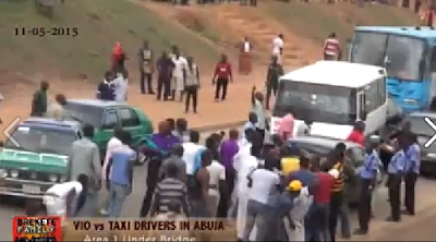 Watch Video Of The Epic Showdown Between VIO Officials And Taxi Drivers In Abuja