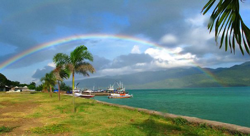 Rainbow In Flores Beach