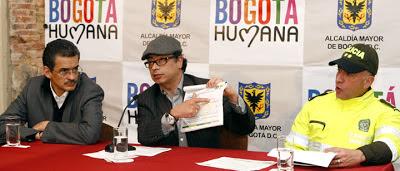 Mayor of Bogotá wearing his trademark Cuban style flat-cap