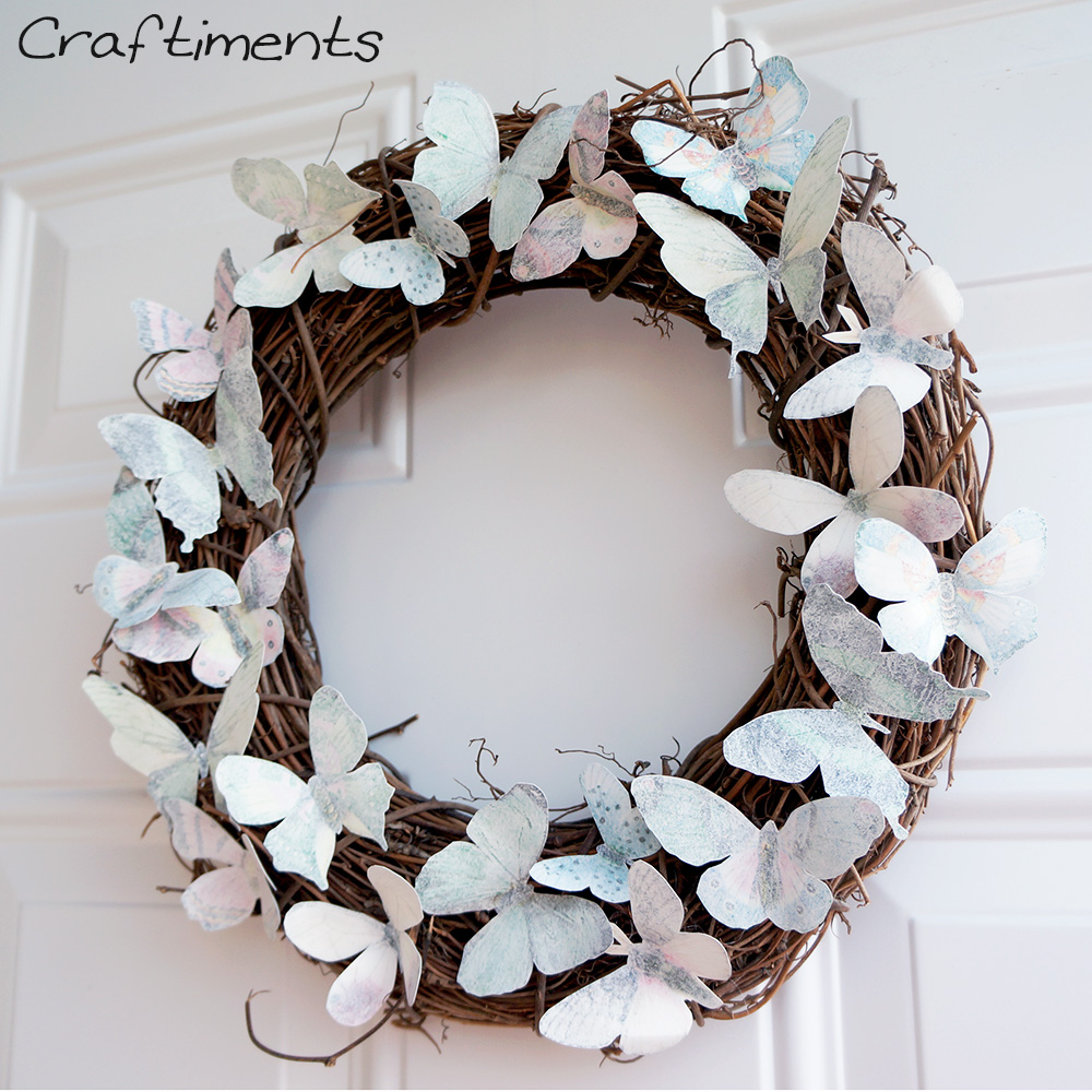 Paper butterflies glued to a grapevine wreath