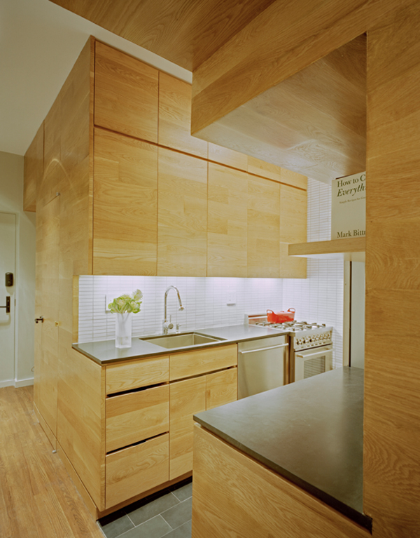 Photo of interiors of small kitchen located right next to the entrance