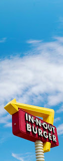 Photo of IN-N-OUT BURGER's outdoor sign as visible from a highway exit