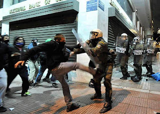 funniest picture: hooligan beats a policeman