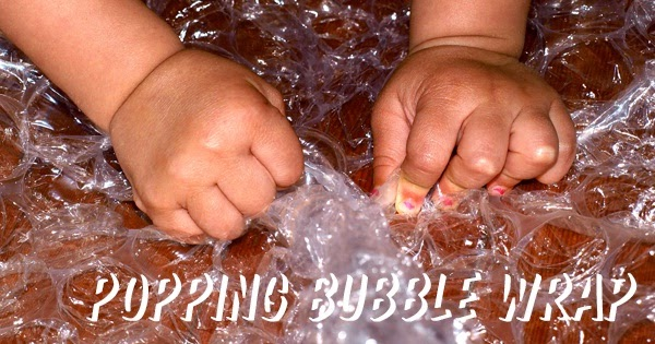 kid popping bubble wrap