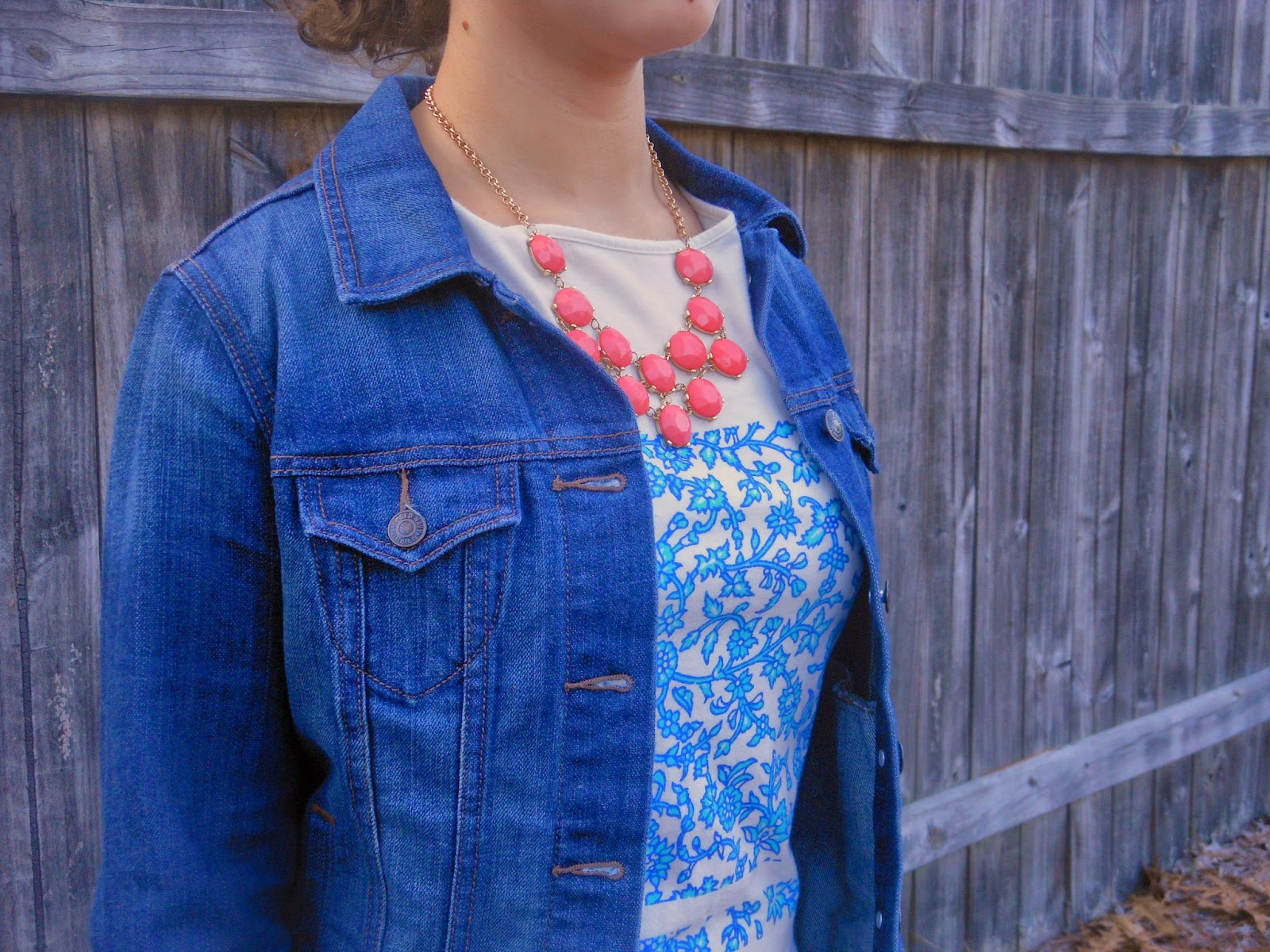 Coral and Bright Blue. Blue patterned top, black skinnies, coral necklace, jean jacket, brown boots .