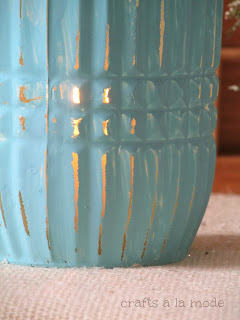 blue painted vase with candle